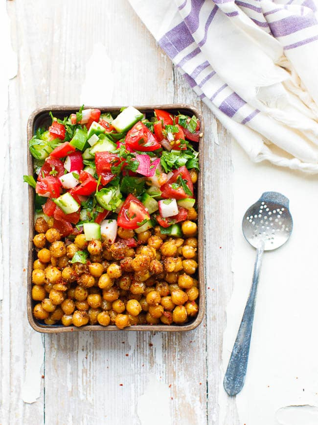 Spiced chickpeas with chopped salad in rectangular bowl, seen from above
