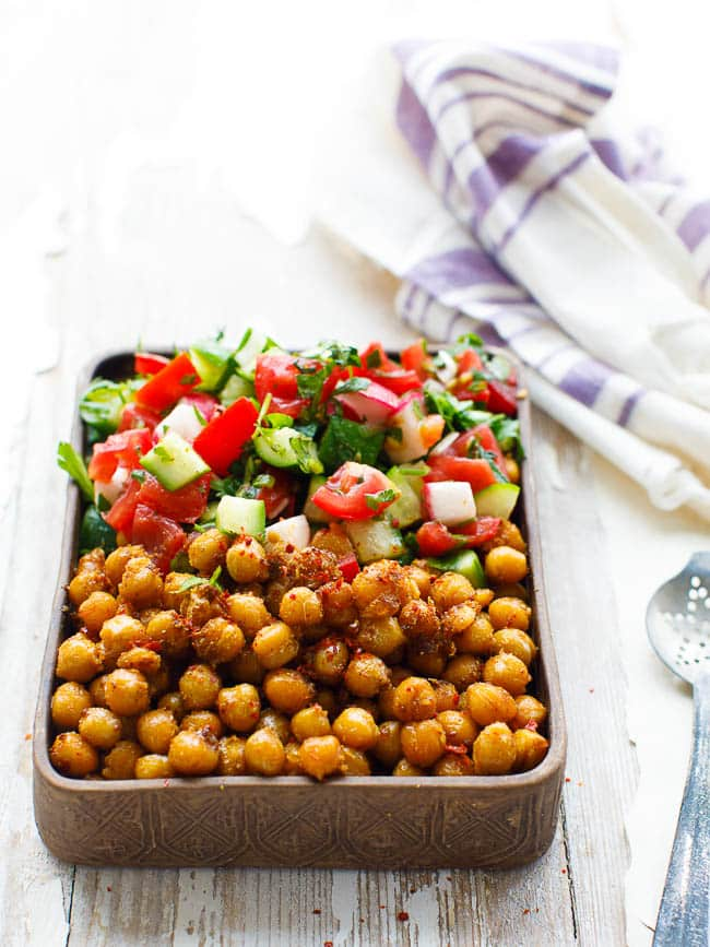 Spiced chickpeas with chopped salad in rectangular bowl, seen from eye level