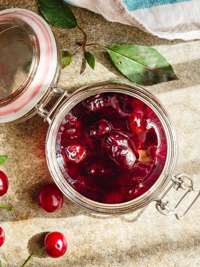 Turkish sour cherry jam in old school jar in sunlight, seen from above