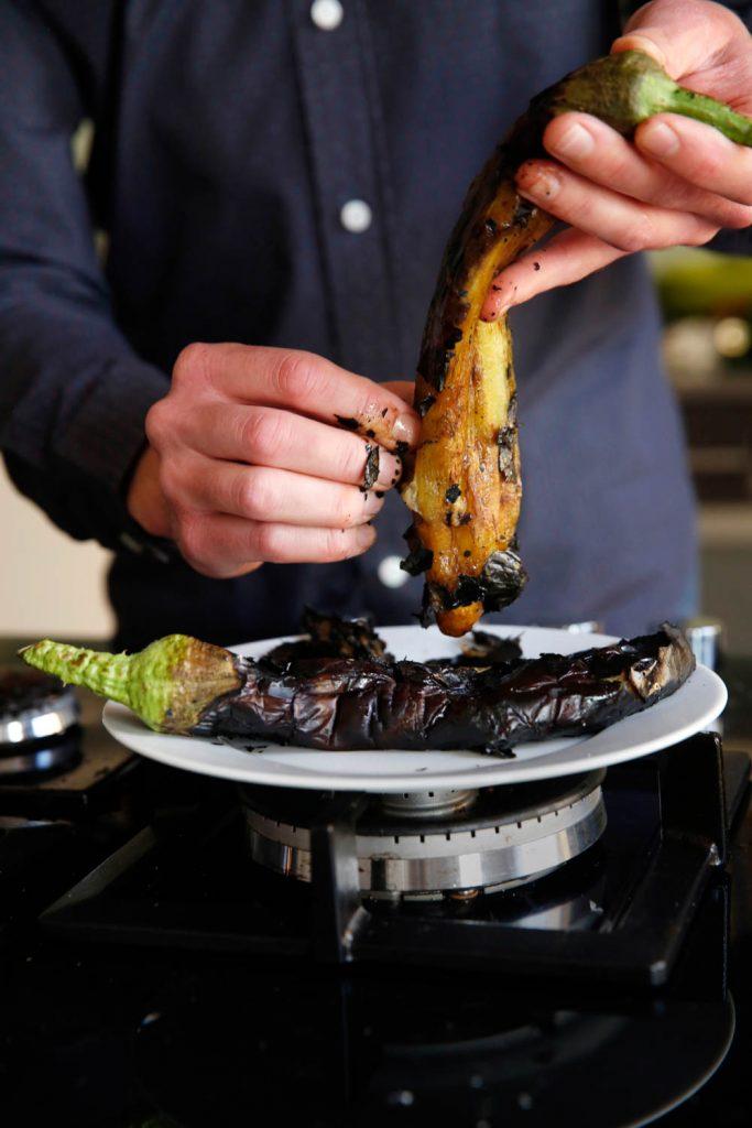 Peeling of burned aubergine