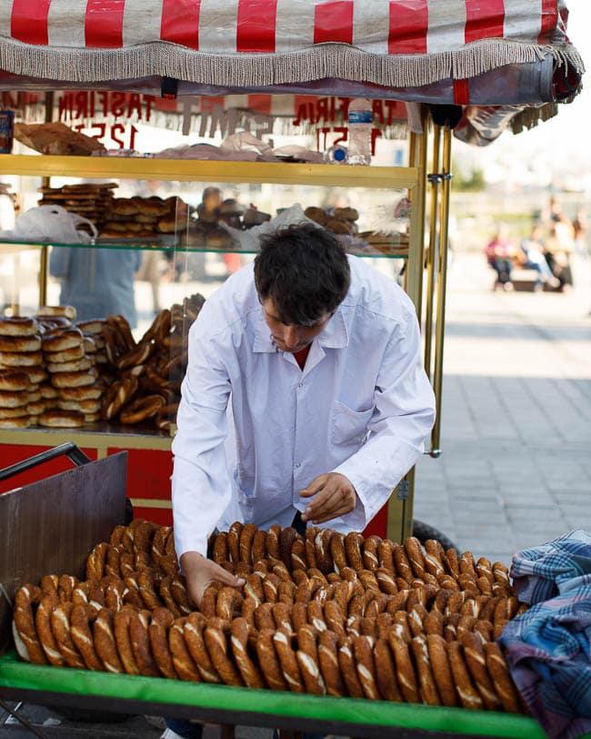 Simit vendor preparing simits for sale outside Istanbul's spice market (Mısır Çarşisi)