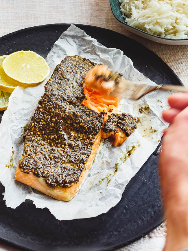Fork piercing a piece of za'atar baked salmon