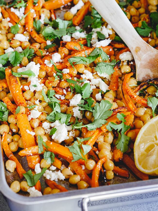 Roast carrots, warm chickpeas and caraway up-close seen from side