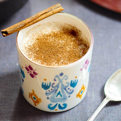 Salep in colourful cup with sprinkling of cinnamon seen from eye-level