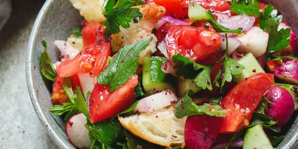Fattoush - Levantine bread and vegetable salad with sumac, shown from side